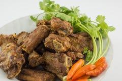 Côtes de découvert de porc frites Photo libre de droits