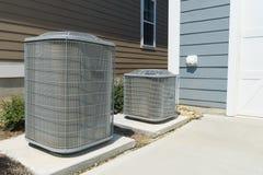 A/C unit. Residential air conditioner compressor unit Stock Photos
