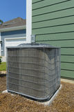 A/C unit. Residential air conditioner compressor unit Stock Images