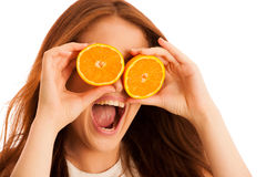 C-vitamine woman - girl with orange fruit in front of her face.  Stock Images
