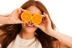 C-vitamine woman - girl with orange fruit in front of her face Royalty Free Stock Photo