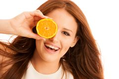 C-vitamine woman - girl with orange fruit in front of her face.  Royalty Free Stock Photography