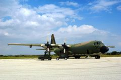C130 Military airplane. Parked in an airbase at daylight Royalty Free Stock Images