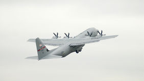 C130 taking off. With vapor trails Stock Photos