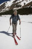 C16 Backcountry Touring. Retro skier skins up Webster Pass in early spring royalty free stock image