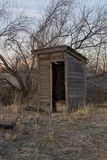 C47 Outhouse at Sunrise. Abandoned Utah Outhouse Stock Photo