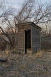 C47 Outhouse at Sunrise. Abandoned Utah Outhouse stock photo