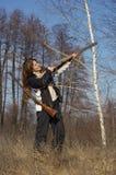 Caçador da mulher com dois injetores Imagem de Stock Royalty Free