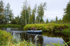 Caçador em um barco Foto de Stock Royalty Free