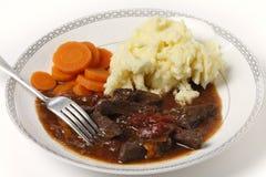 Caçarola da carne e do tomate com forquilha Imagem de Stock