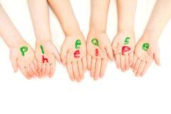 Caçoa as mãos que imploram ajudam por favor Fotografia de Stock Royalty Free