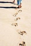 Caçoa os pés com pegadas Foto de Stock Royalty Free