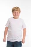 Caçoe o retrato de sorriso do menino do estúdio da criança no branco Imagem de Stock