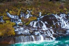 Caída del agua de Hraunfossar Foto de archivo