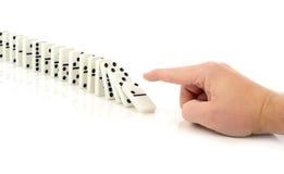 Caída del dominó Imagenes de archivo