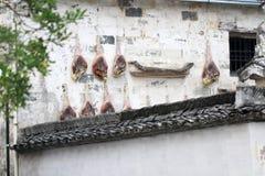 Caída del tocino en la pared Foto de archivo libre de regalías