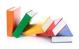 Caída en blanco colorida de muchos libros Fotografía de archivo libre de regalías