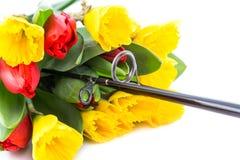 Caña de pescar con las flores de la primavera del ramo Imagen de archivo