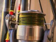Caña de pescar, flotador y primer del carrete de la pesca Foto de archivo libre de regalías