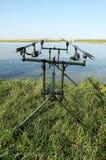Cañas de pescar en el lago Imagenes de archivo