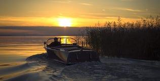 Cañas y barco de motor Imagen de archivo libre de regalías