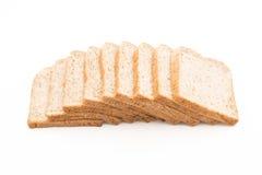 Całej banatki chleb na bielu obrazy stock