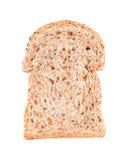 Całość zbożowego chleba Ciącego nad białym tłem, chlebowy plasterek odizolowywa Fotografia Stock