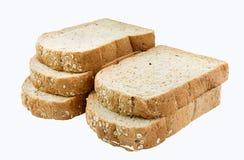 Całość zbożowych chlebowych plasterków, odosobnionych na bielu Zdjęcie Royalty Free