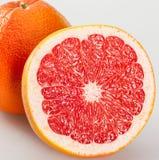 Całości i cięcia grapefruits Obraz Royalty Free