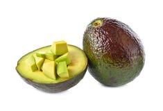 Całości i porci rżnięty Avocado na bielu Fotografia Royalty Free