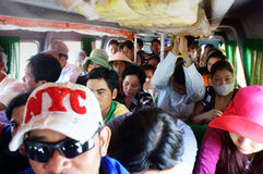 Passenger sit in overcrowded on passenger boat. CA Royalty Free Stock Image