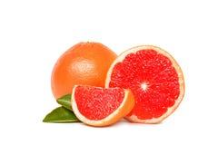 Ca?o?ci i ci?cia dojrzali grapefruits na bielu fotografia royalty free