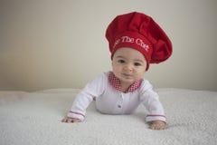 Całuje dziecko szefa kuchni Obrazy Royalty Free