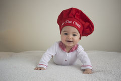 Całuje dziecko szefa kuchni Zdjęcia Stock