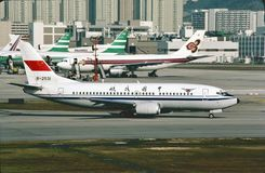 CAAC Boeing B-737 taxiing to the gate at Hong Kong Kai Tak Airport on December 13, 1986 Royalty Free Stock Images