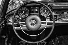 Cab driver of the car Mercedes-Benz W113, 280SL. BERLIN - MAY 11: Cab driver of the car Mercedes-Benz W113, 280SL, (black and white), 26th Oldtimer-Tage Berlin Royalty Free Stock Photography