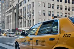 Cab by empire state building. A shot of a cab stopped at the red light in midtown manhattan Stock Photos