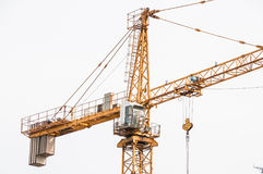Cab lifting crane in the construction site. Building Stock Photos