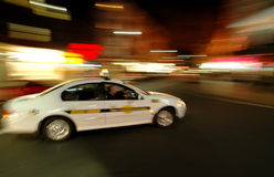 Cab in motion. Blurred picture of Sydney taxi taking a corner Stock Photos