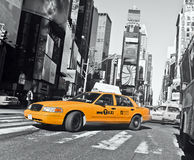 Cab at Times Square. Taxi on the Times Square Street of New York in black and white with yellow cabs, Manhattan.Photo taken on Feb 20thth, 2011 stock images