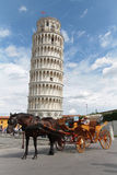 A cab waits in front of the tower of Pisa Stock Photos