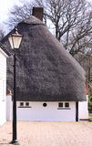 Cabaña blanca de la paja Fotografía de archivo libre de regalías