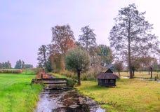 Cabaña cerca de un canal Foto de archivo libre de regalías