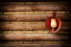 Cabaña de madera con la linterna Imagenes de archivo