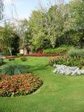 Cabaña de piedra en jardín formal Fotos de archivo libres de regalías