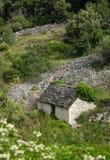 Cabaña de piedra vieja Fotografía de archivo