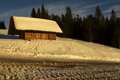 Cabaña en invierno Foto de archivo