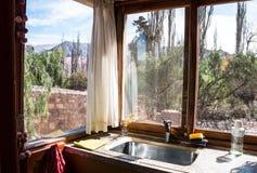 Windows with outdoor mountain view on a corner kitchen royalty free stock photos