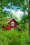 Cabaña sueca roja Imagenes de archivo