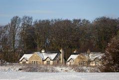 Cabañas en la nieve Imágenes de archivo libres de regalías
